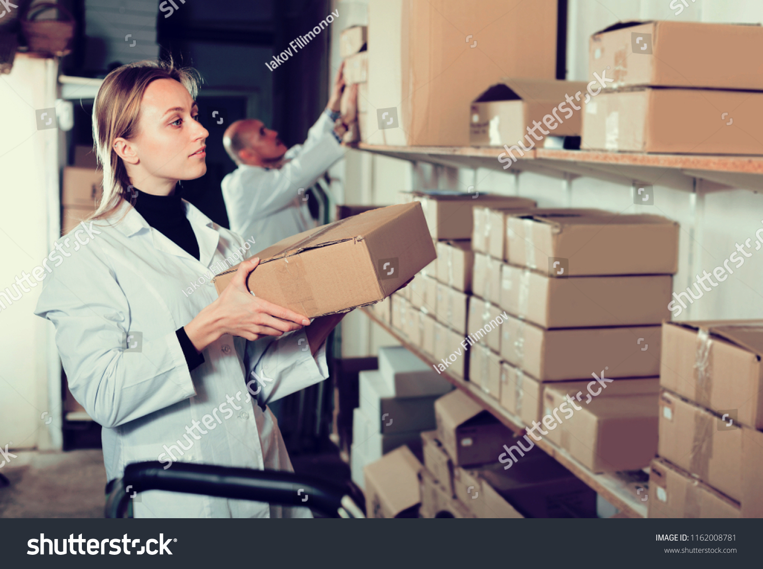 woman worker standing boxes production workplace stock photo edit