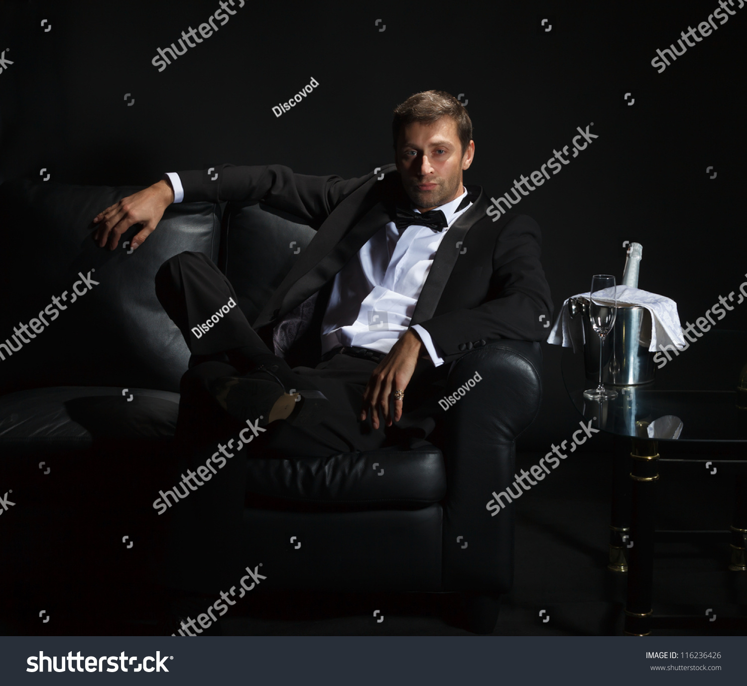 Sexy Handsome Man In Tuxedo Sitting In The Darkness Of A ...