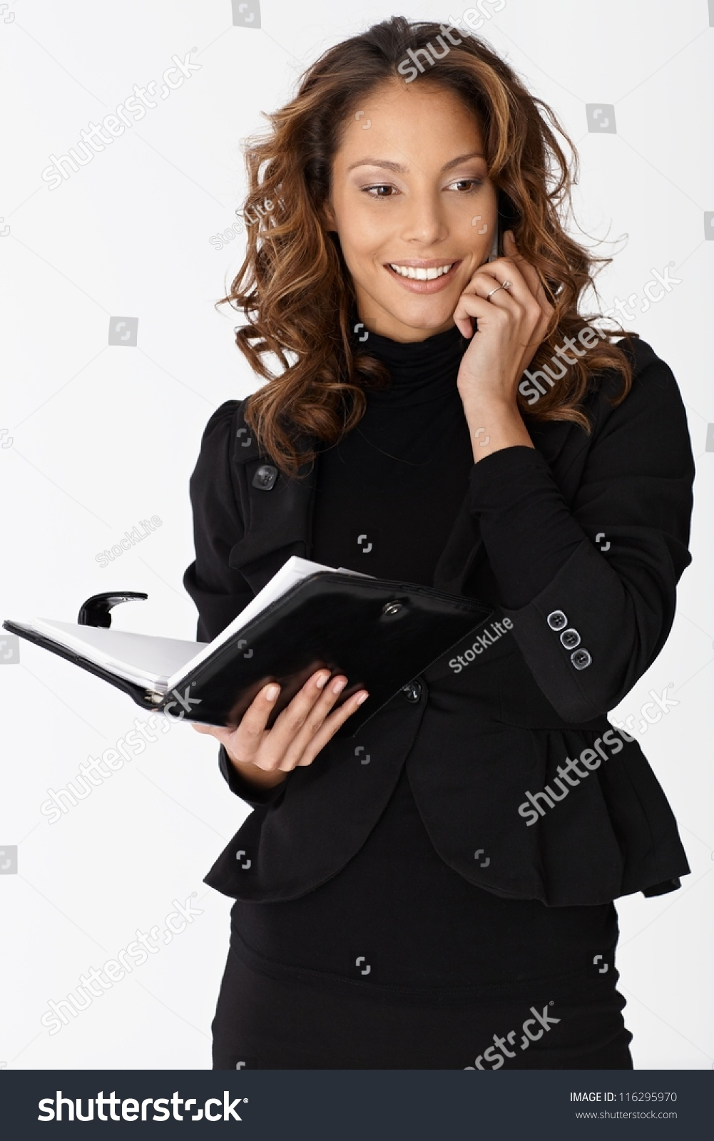 Attractive Ethnic Businesswoman Talking On Mobile Phone