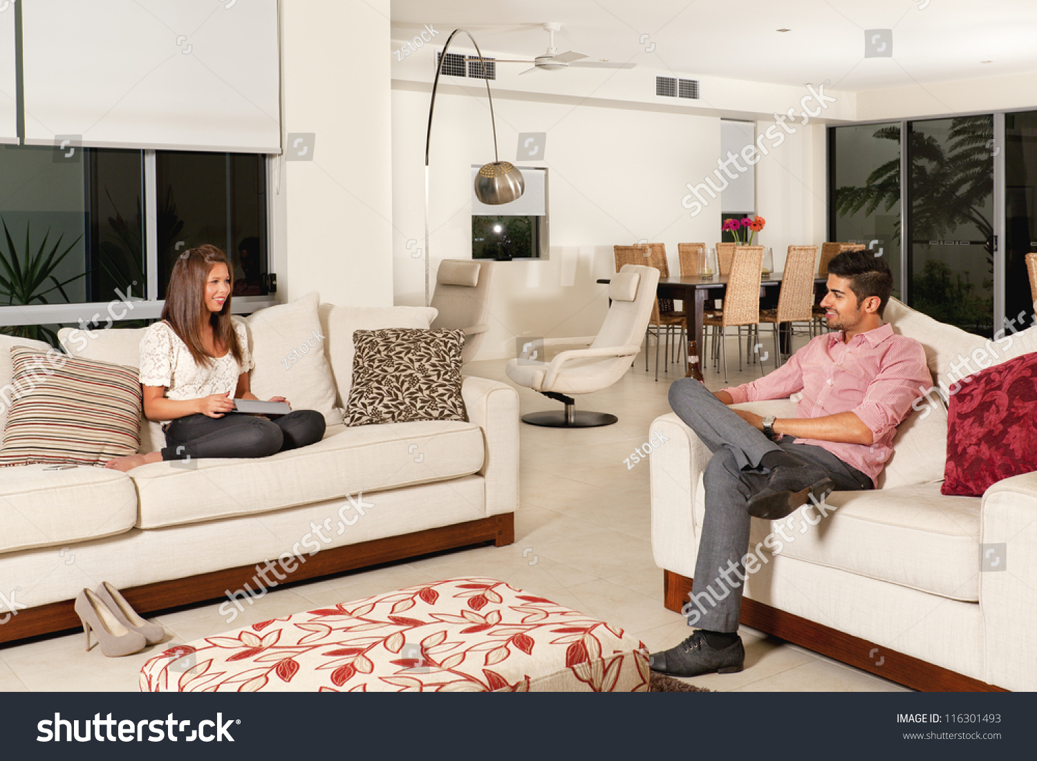 Young couple relaxing modern living room stock photo for Young modern living room