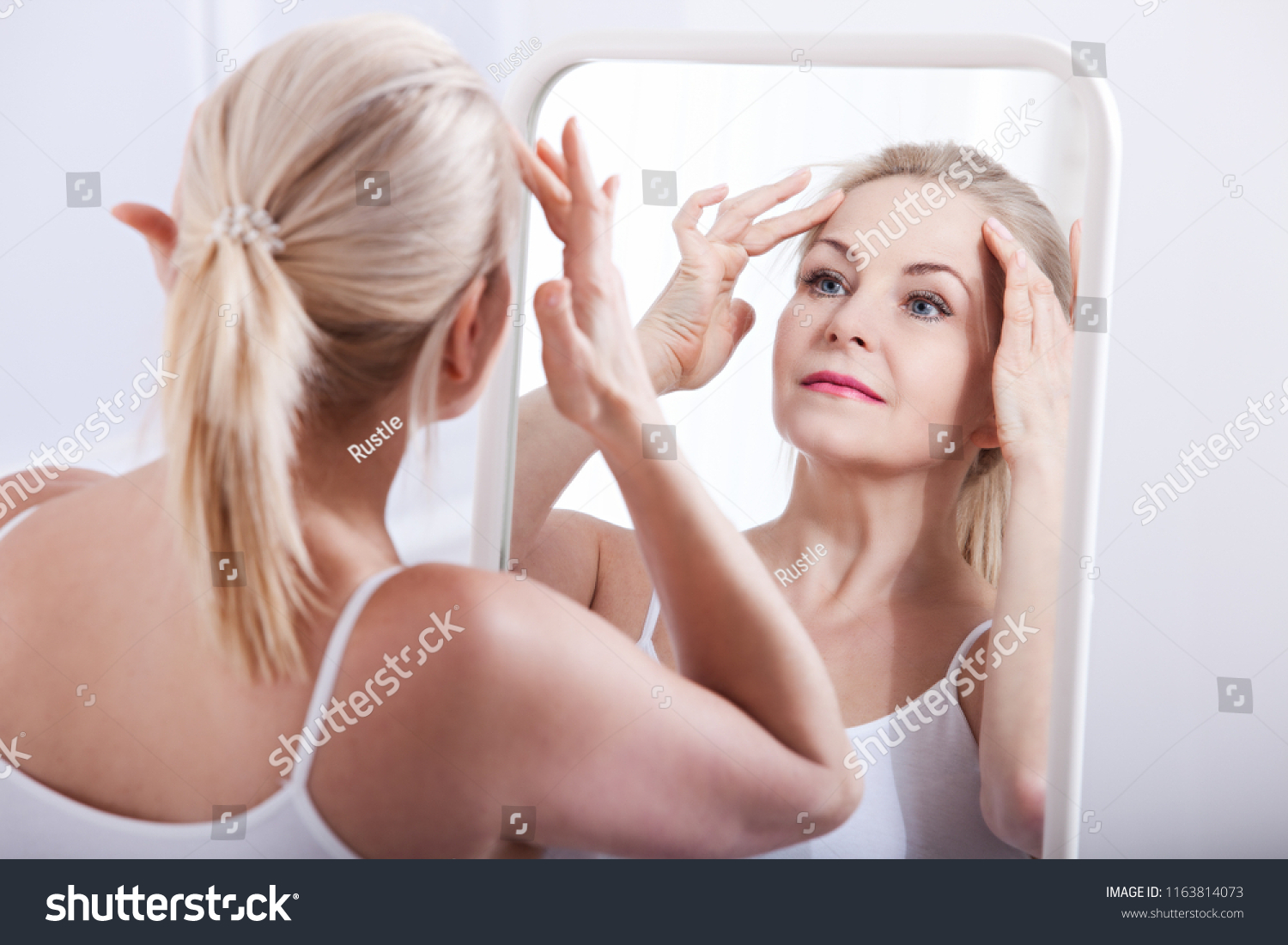 Erotic pictures of women looking in mirrors will