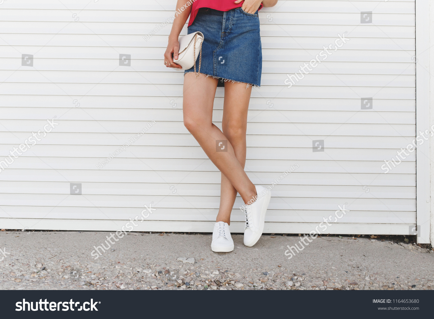 b8edb6a488623 Details of trendy casual summer or spring outfit. Woman wearing denim mini  skirt, pink