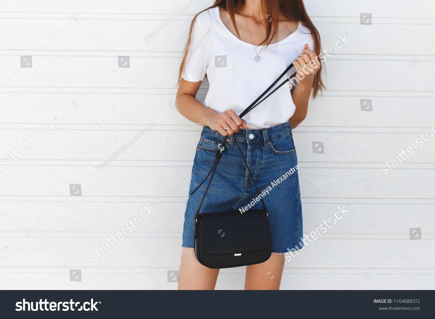51a79a391ddac Details of trendy casual summer or spring outfit. Woman wearing blue denim  mini skirt,