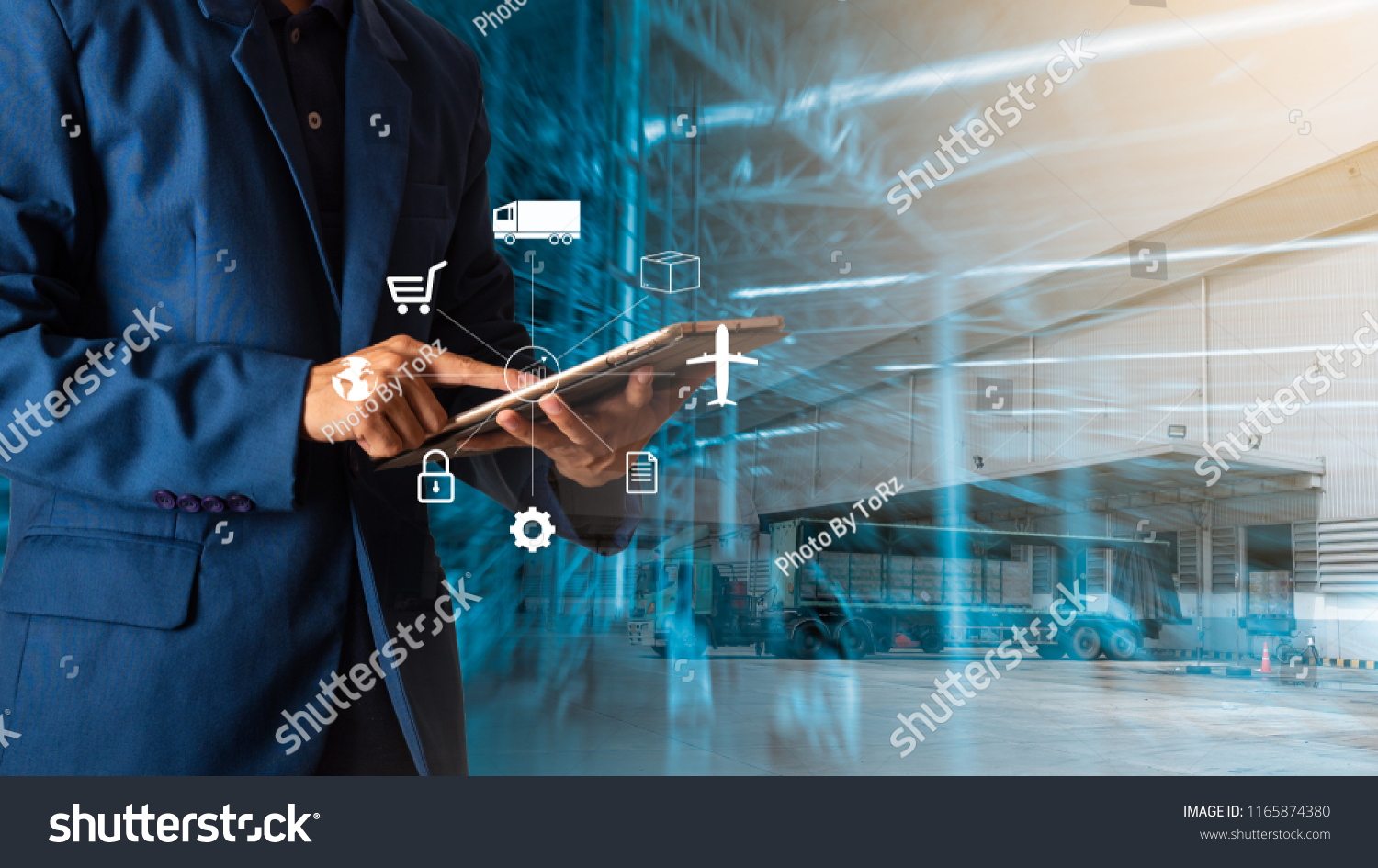 Logistic and transport concept : Businessman manager using tablet check and control and planning for Modern Trade warehouse logistics. #1165874380