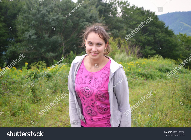 Beautiful Lush Girl Posing Against Backdrop Stock Photo Edit Now 1165933300