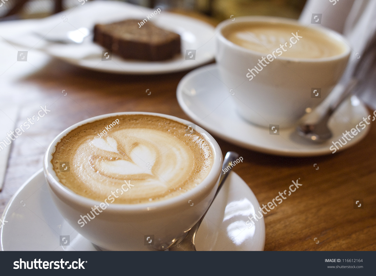 Two cups coffee on table latte stock photo 116612164 shutterstock two cups of coffee on the table latte art geotapseo Gallery