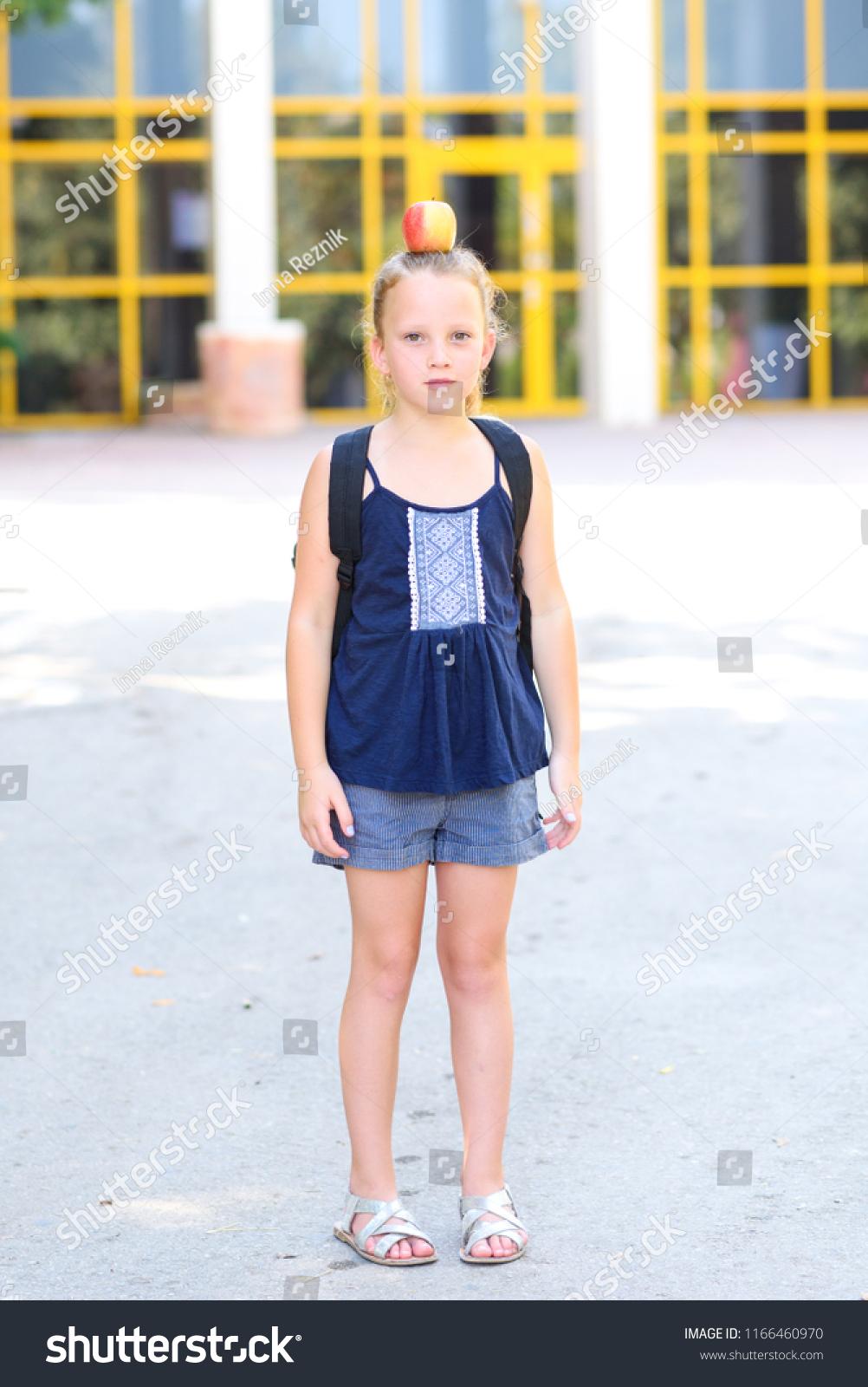 Happy Girl Apple Standing On Her Stock Photo (Edit Now