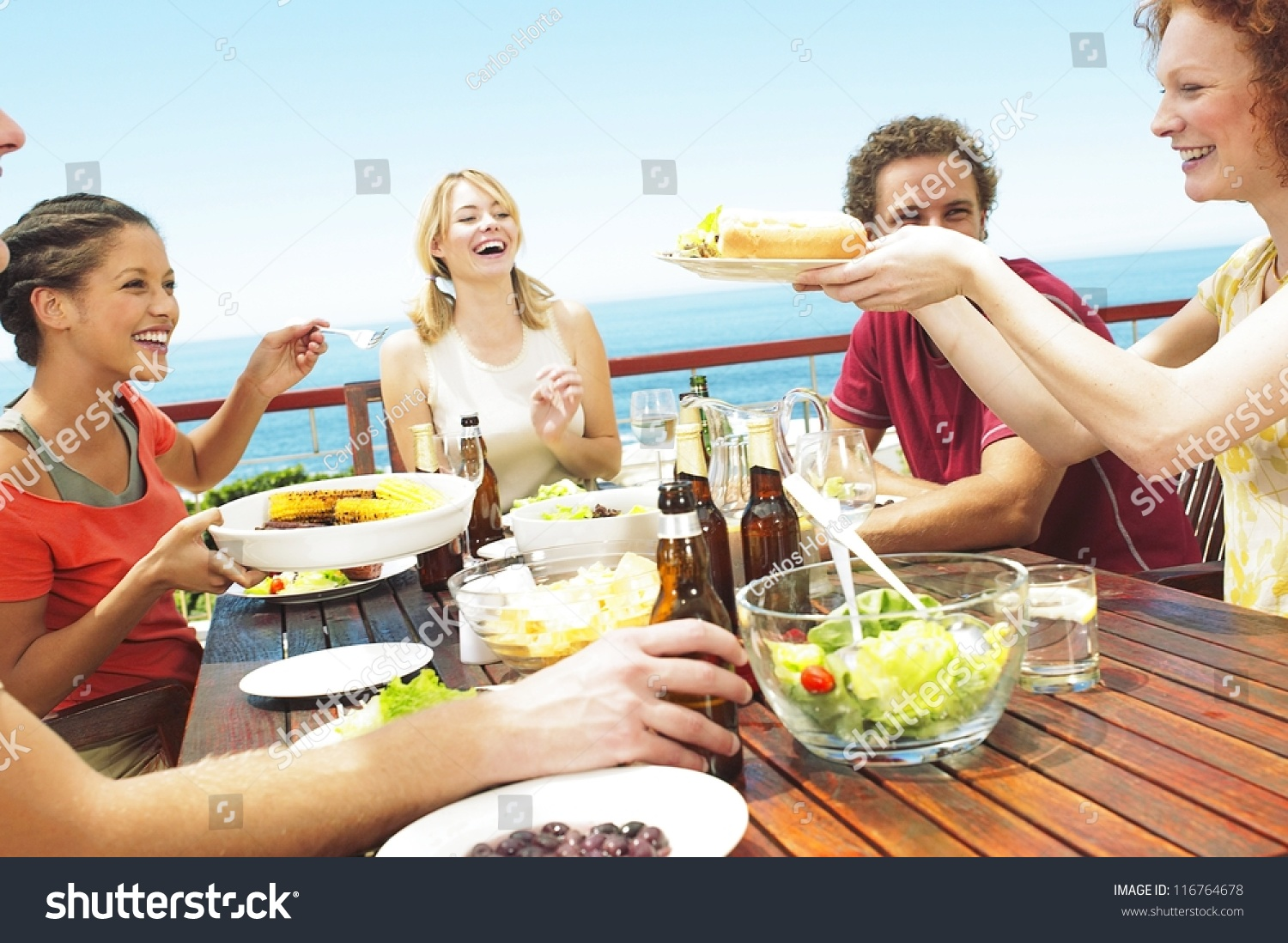 Happy group teenage friends sitting table stock photo for Group lunch