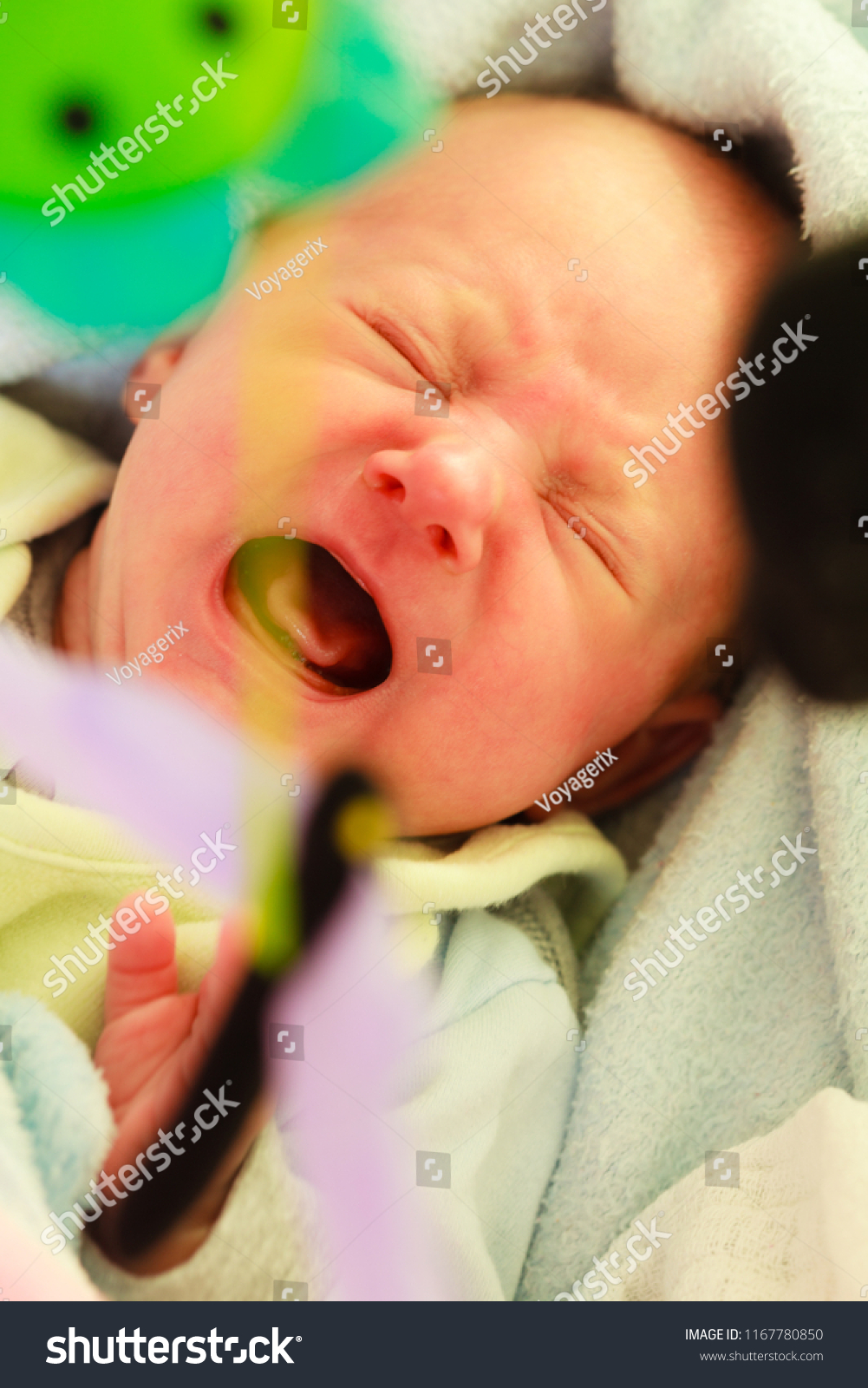 Little newborn baby crying in baby cot