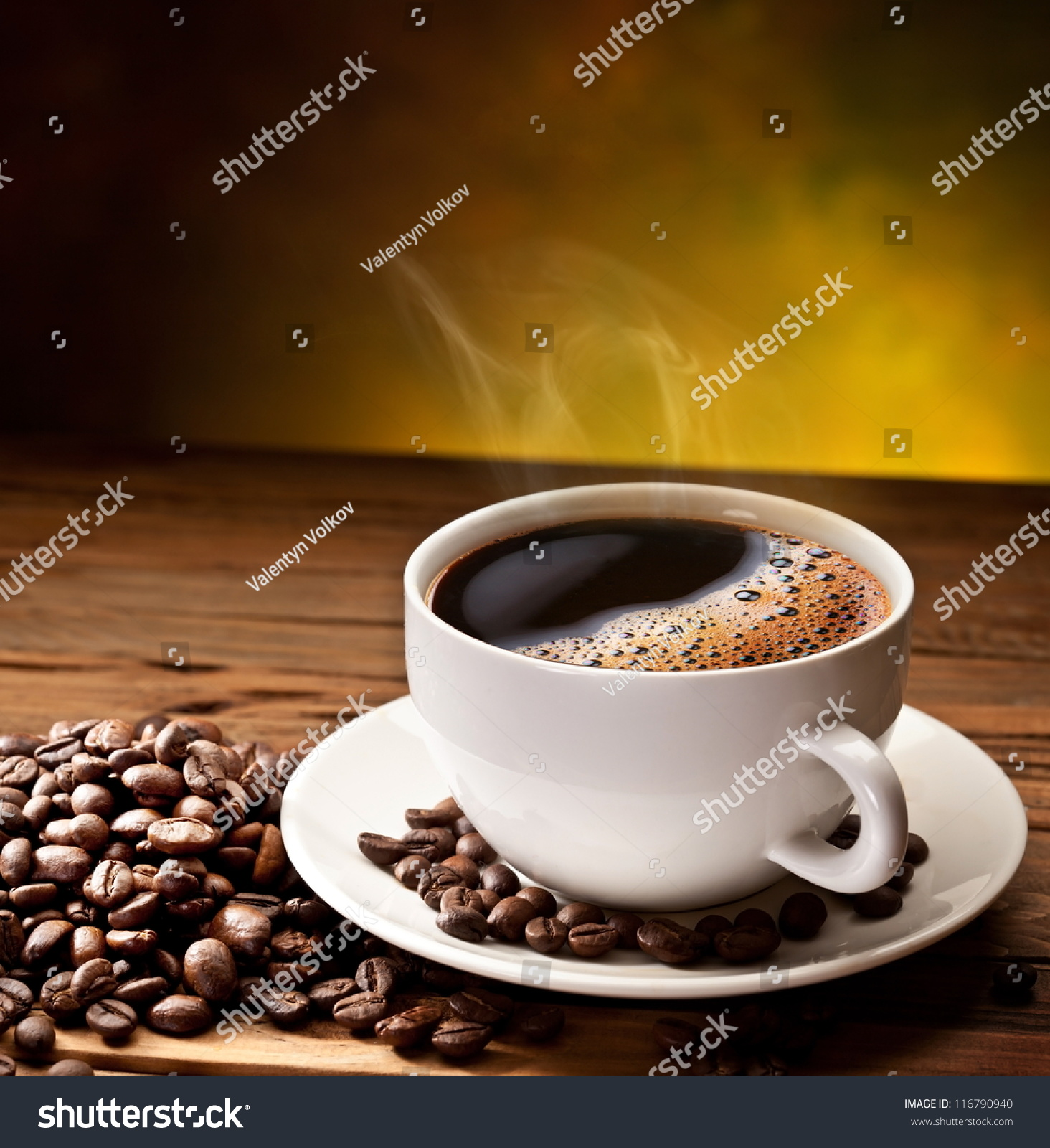 Coffee cup saucer on wooden table stock photo 116790940 shutterstock coffee cup and saucer on a wooden table dark background geotapseo Gallery