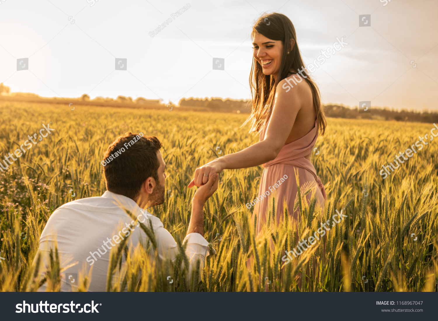 Will you marry me? Men making proposal for his girlfriend at field #1168967047