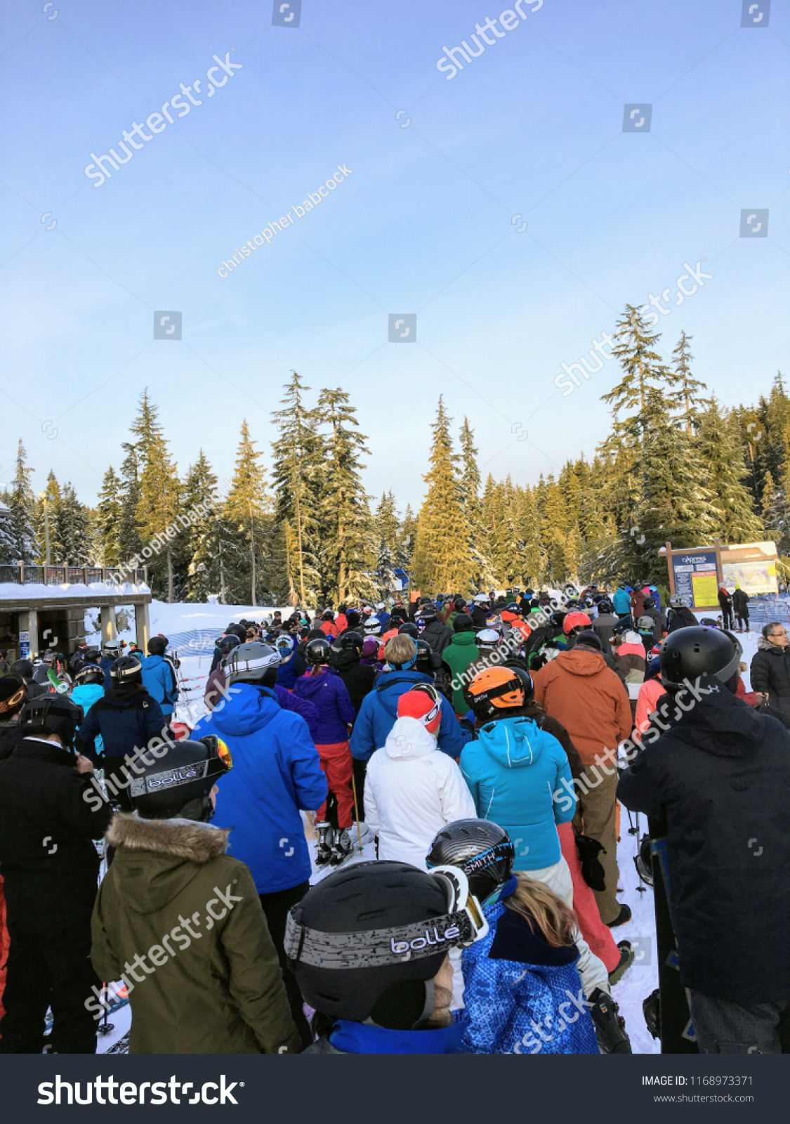 stock-photo-west-vancouver-cypress-mountain-canada-january-st-a-long-lineup-of-anxious-skiers-and-1168973371.jpg