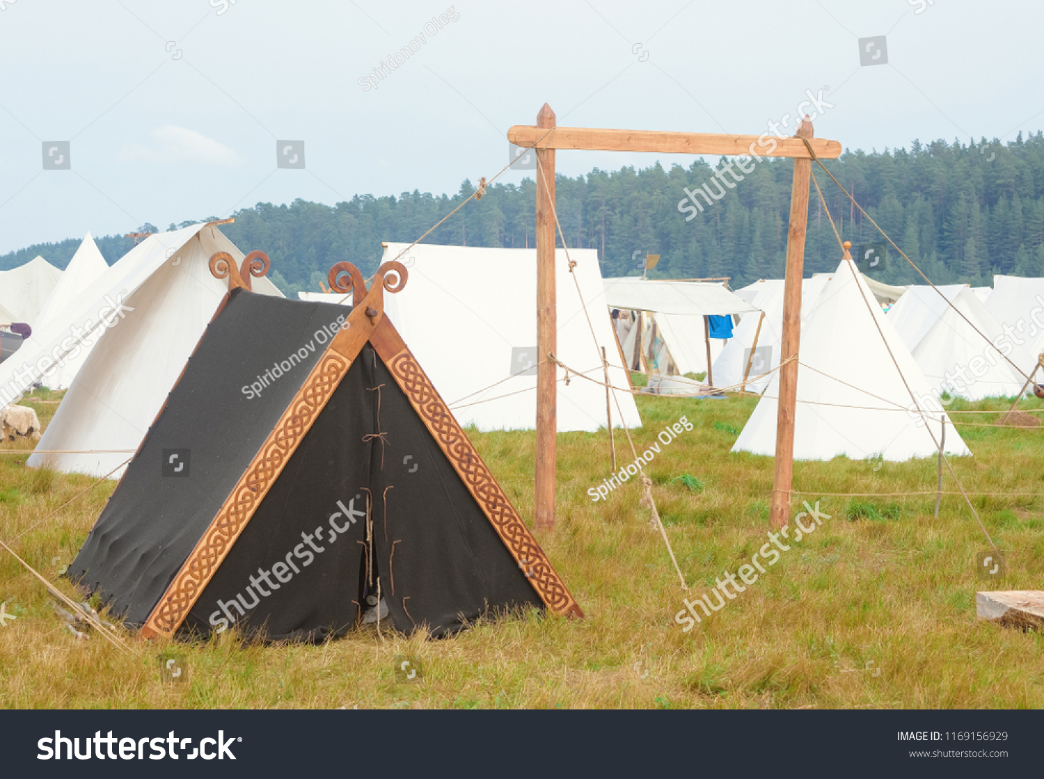 Old Russian campground, black tent in nature tent city, tent in the tent city #1169156929