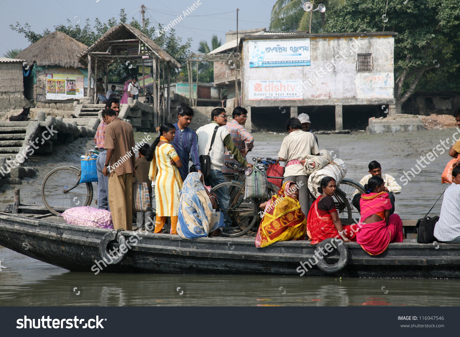 Gosaba India  city photos : GOSABA, INDIA JANUARY 19: wooden boat crosses the Ganges River ...