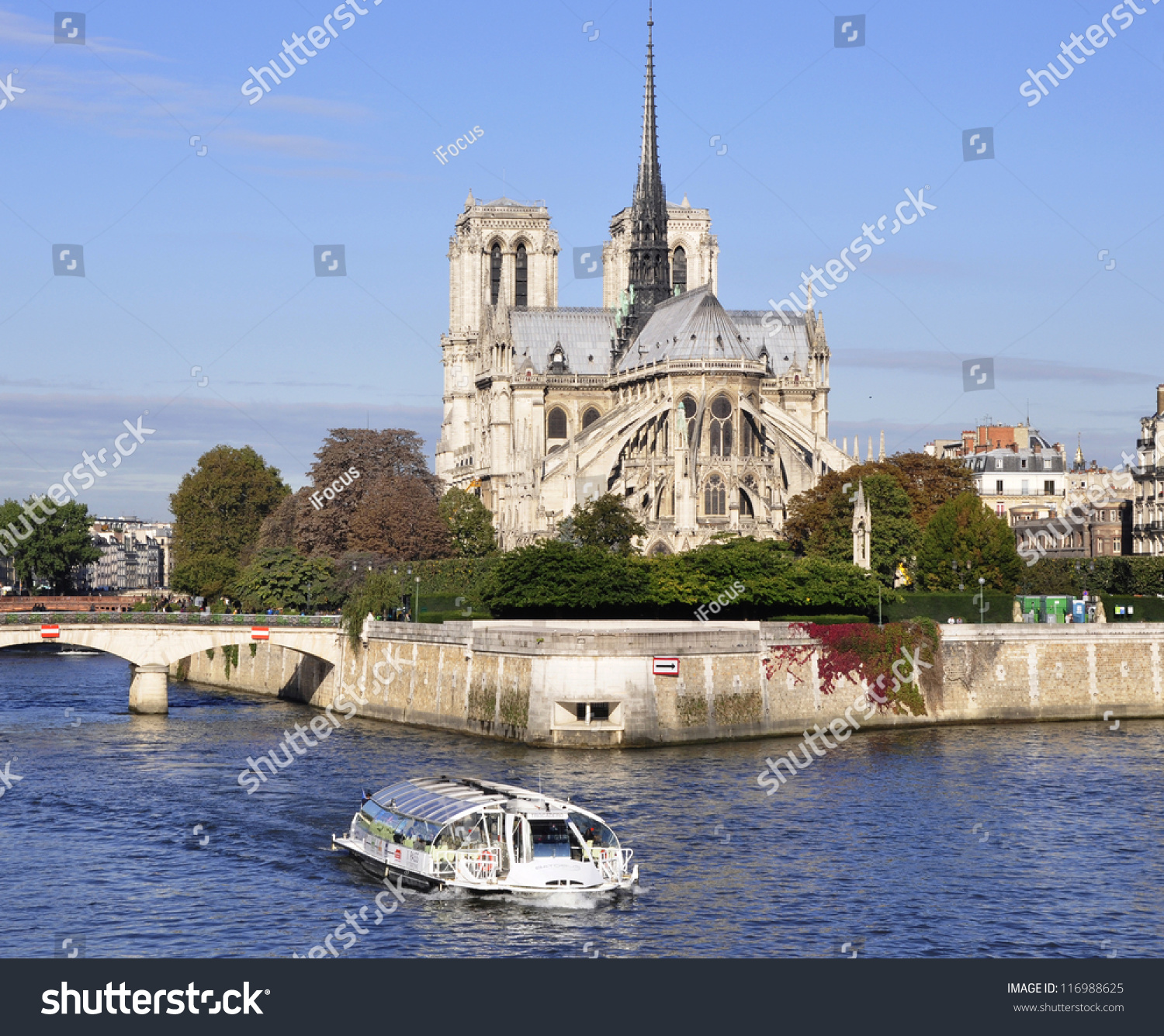 River boat on the river Seine passing in front of Notre-Dame in Paris