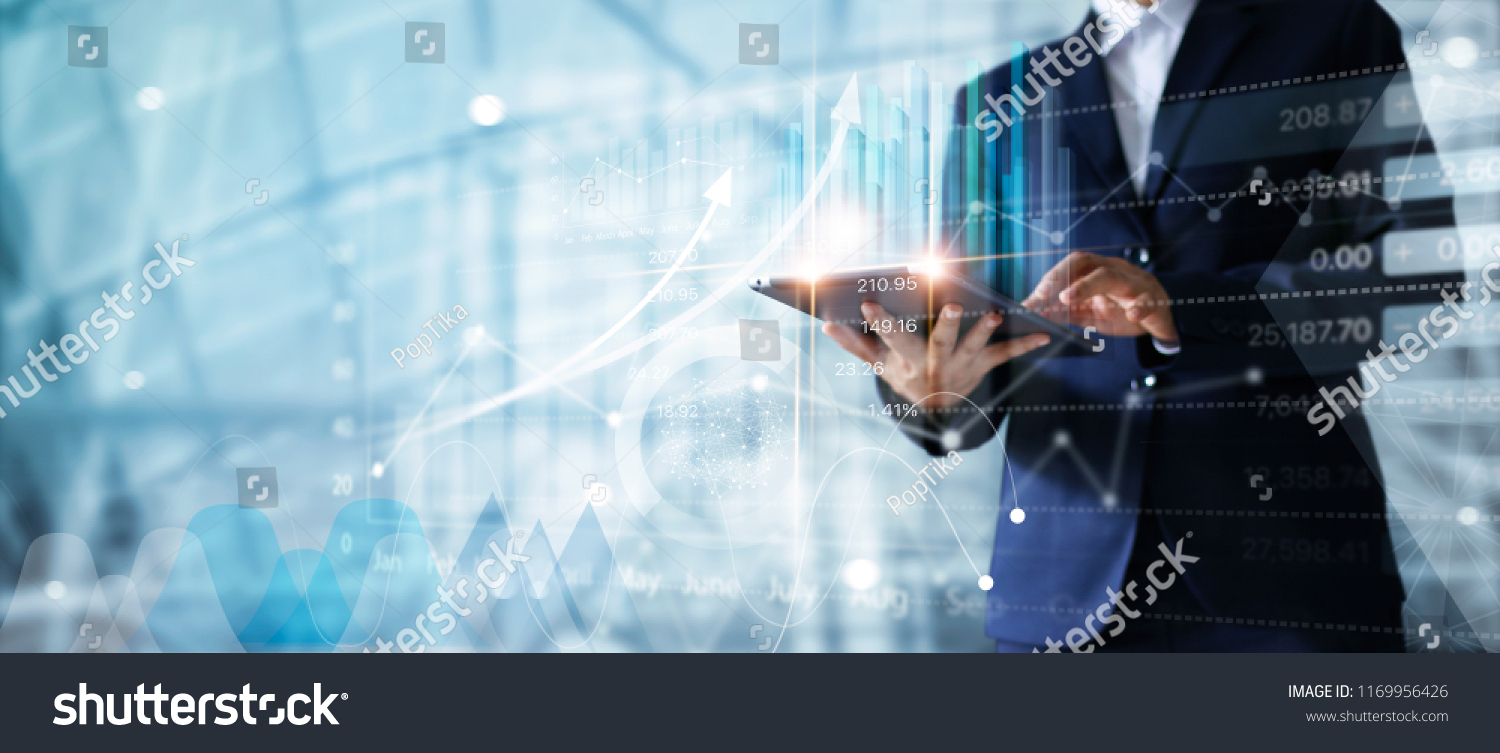 Businessman using tablet analyzing sales data and economic growth graph chart.  Business strategy. Abstract icon. Digital marketing. #1169956426
