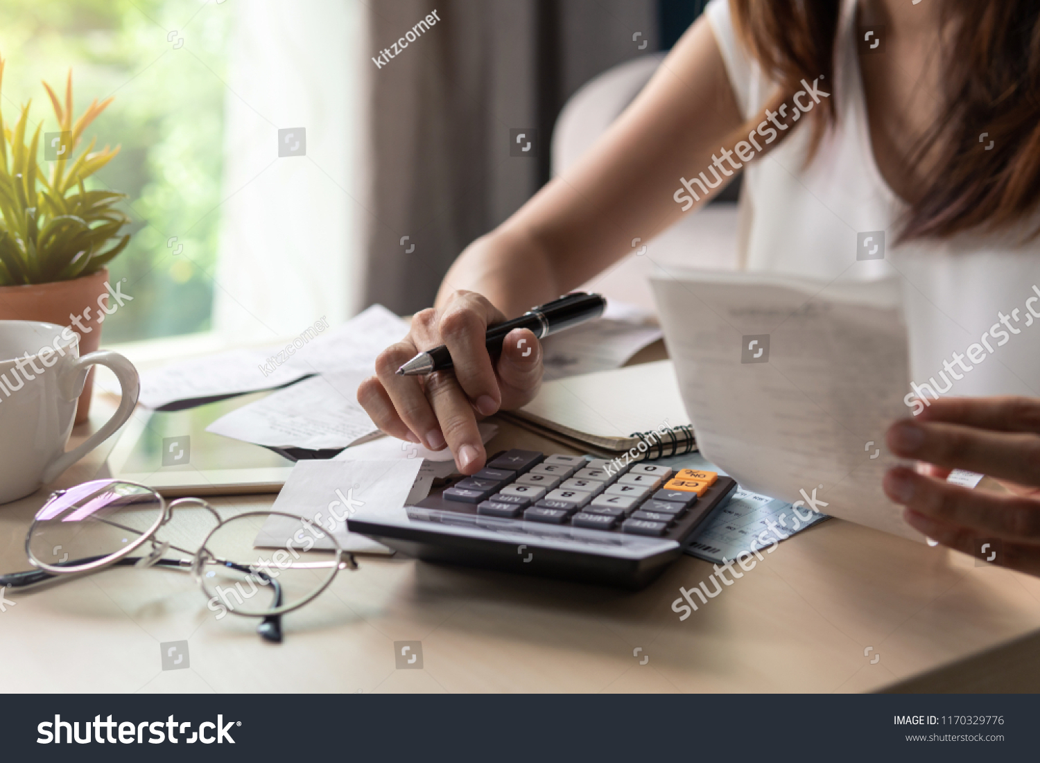 Stressed young woman calculating monthly home expenses, tax, bank account balance and credit card bills payment, Income is not enough for expenses. #1170329776