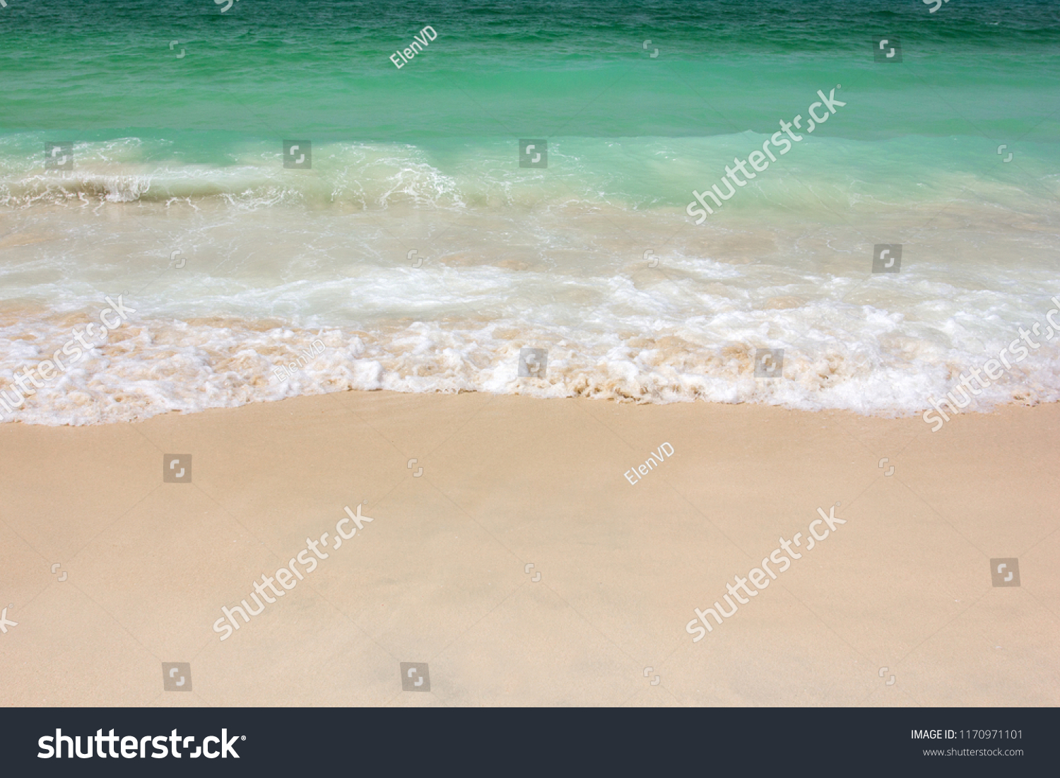 Sea surf of turquoise water on a sandy beach #1170971101