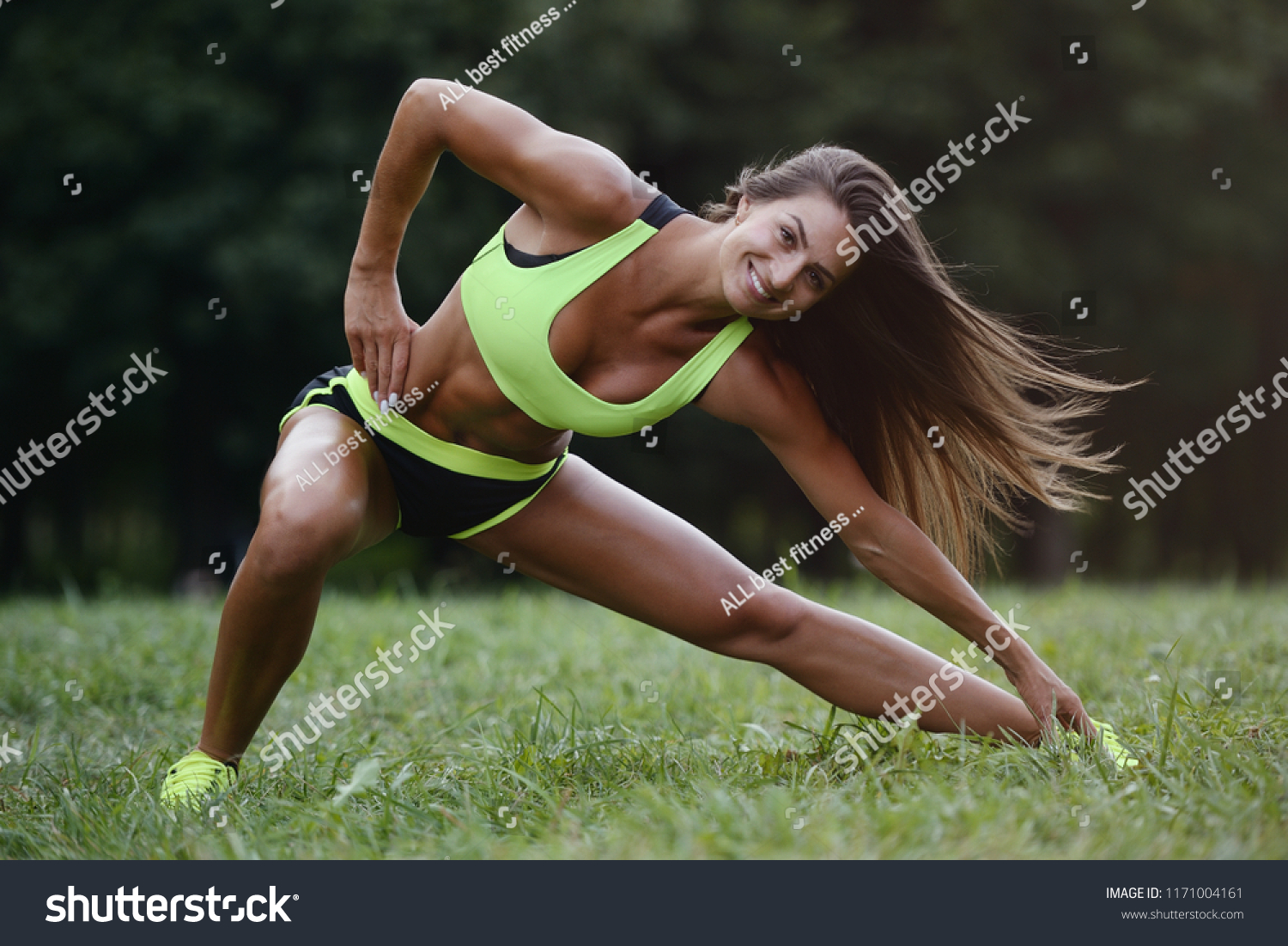 outdoor sport Beautiful strong sexy athletic muscular young caucasian  fitness woman workout training in the gym