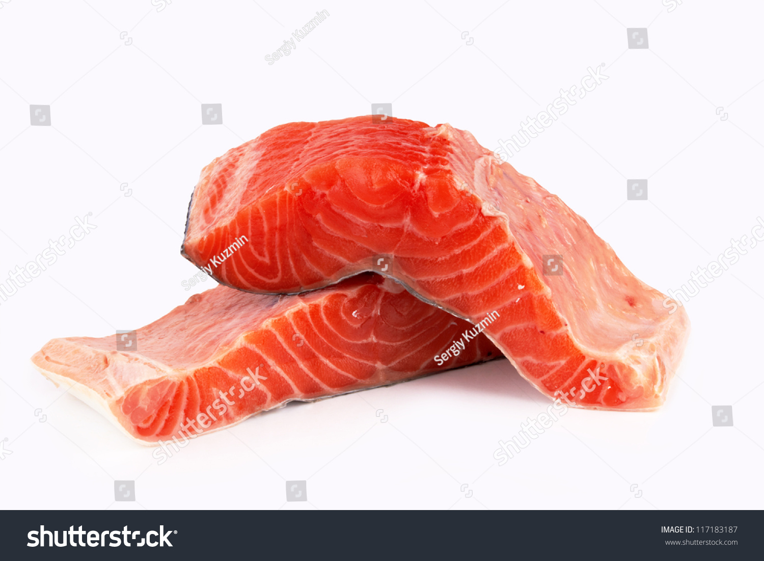 Fresh uncooked red fish fillet over white stock photo for Red fish fillet
