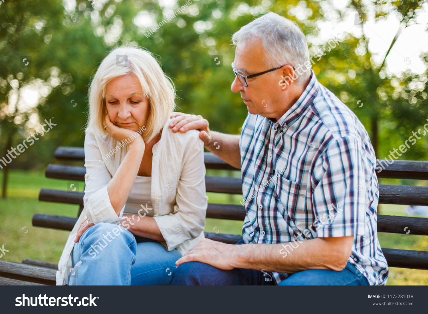 Senior woman is sad and depressed. Friend is consoling her.