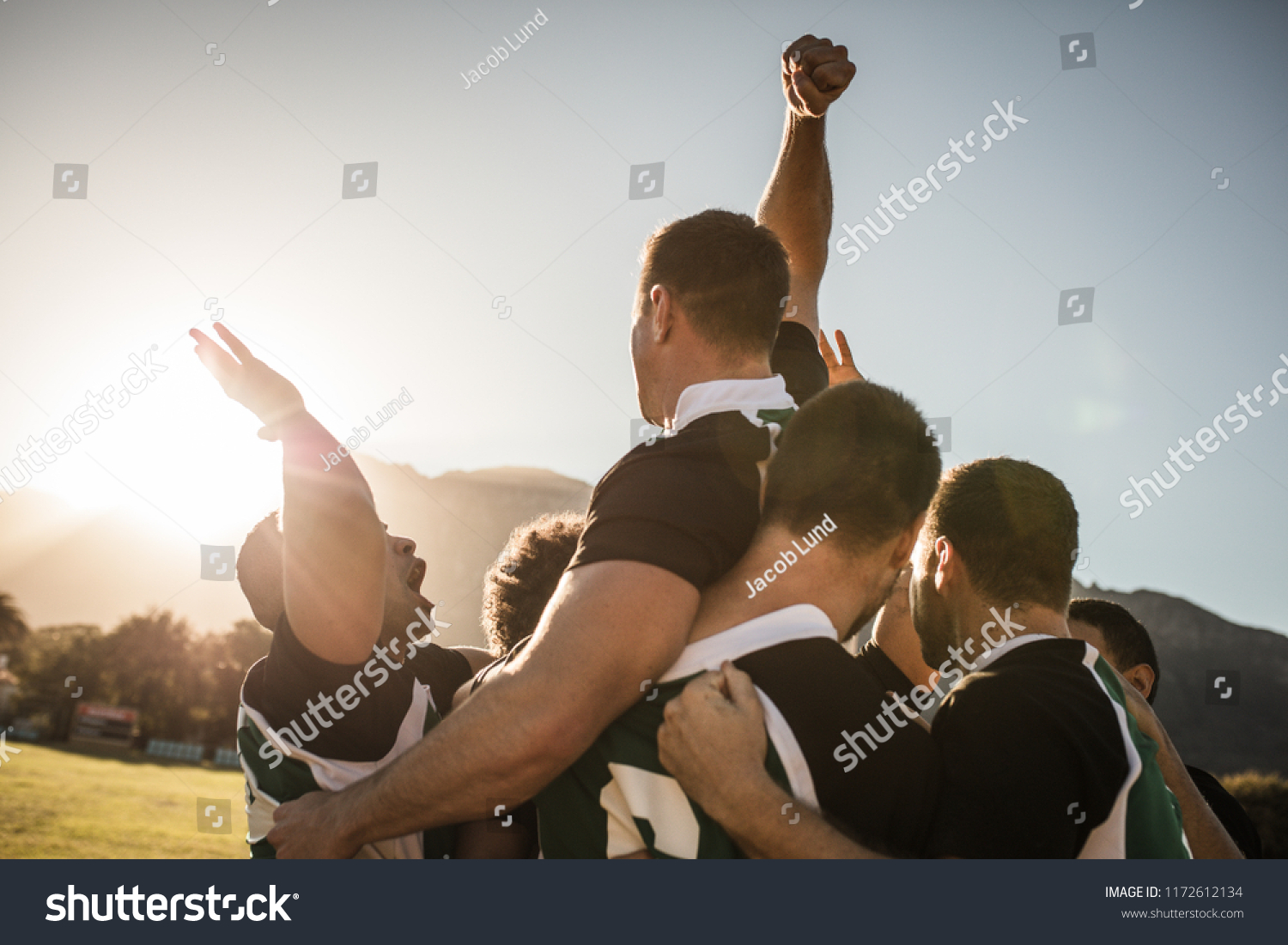 Rugby players lifting the teammate after winning the game. Rugby team celebrating the victory. #1172612134