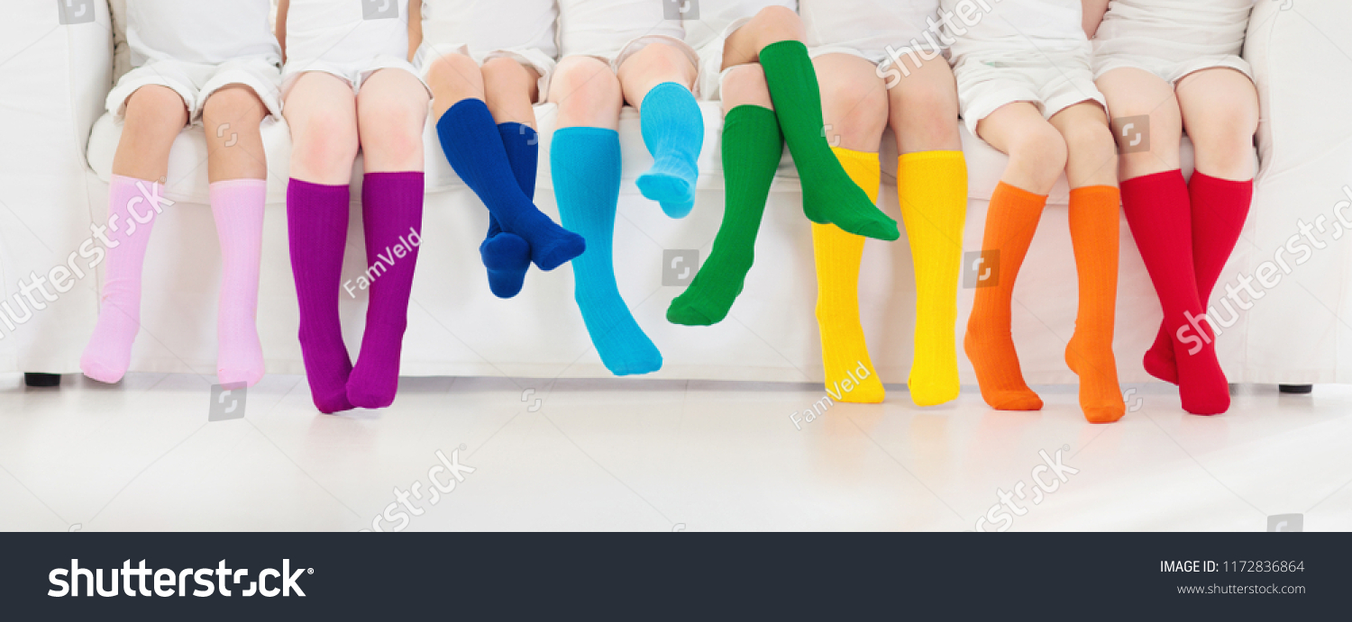 bb4dd1817a9 Kids wearing colorful rainbow socks. Children footwear collection. Variety  of knitted knee high socks