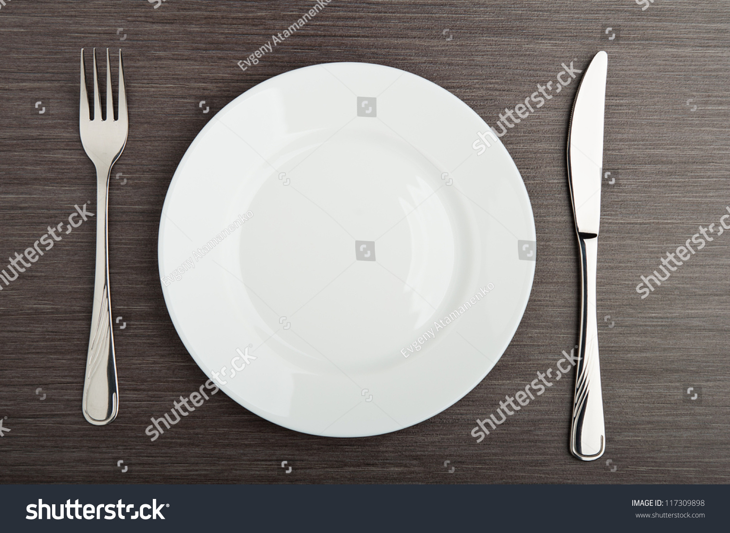 An empty white dish with knife and fork on a table - Table Setting Plate Fork Knife White Empty