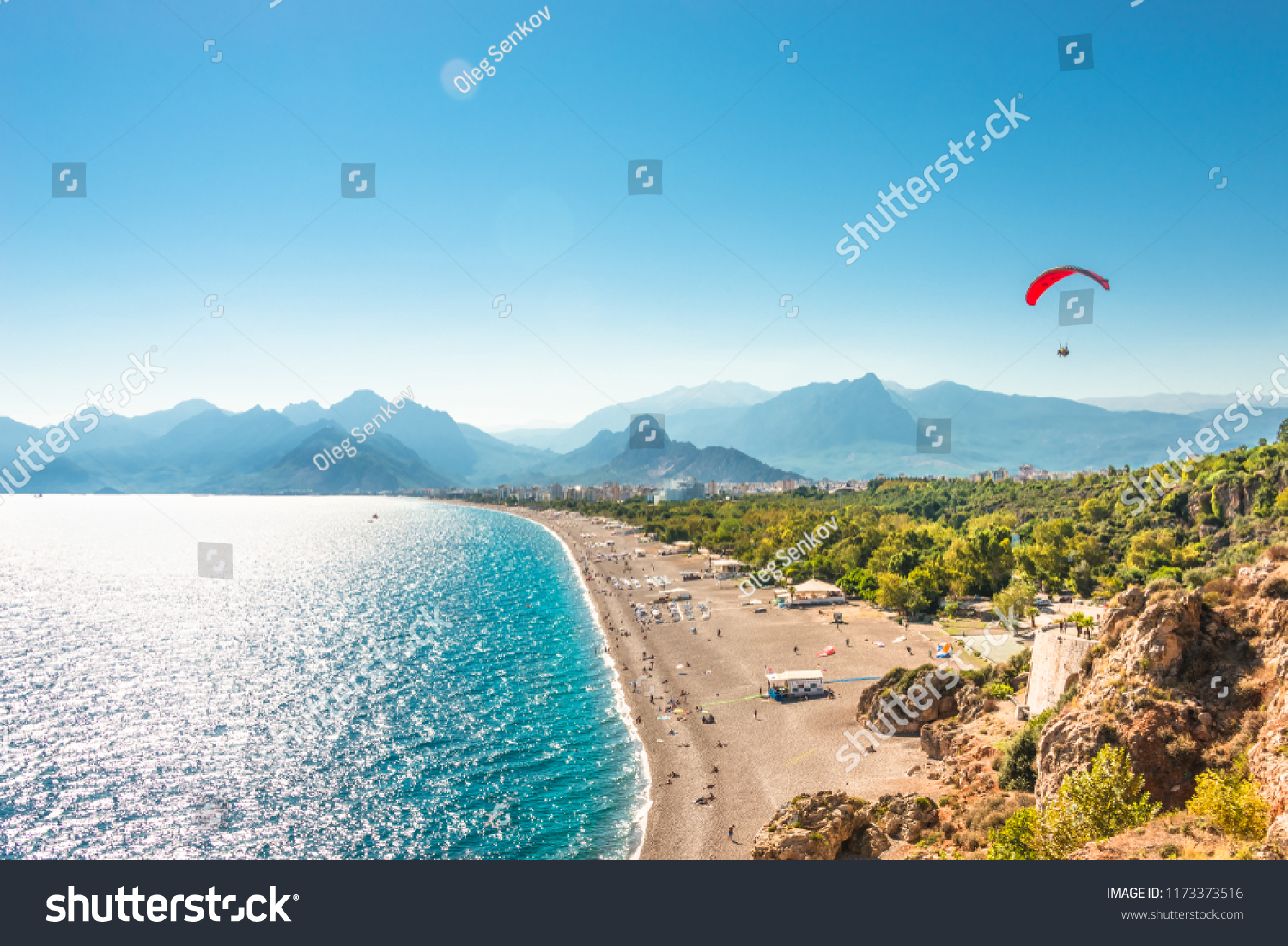 Panoramic bird view of Antalya and Mediterranean seacoast and beach with a paraglider, Antalya, Turkey, Autumn #1173373516