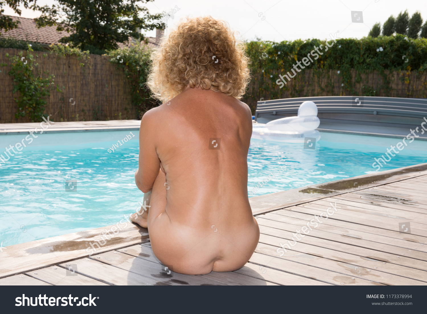 Nude At Home fit senior woman nude on beach stock photo (edit now) 1173378994