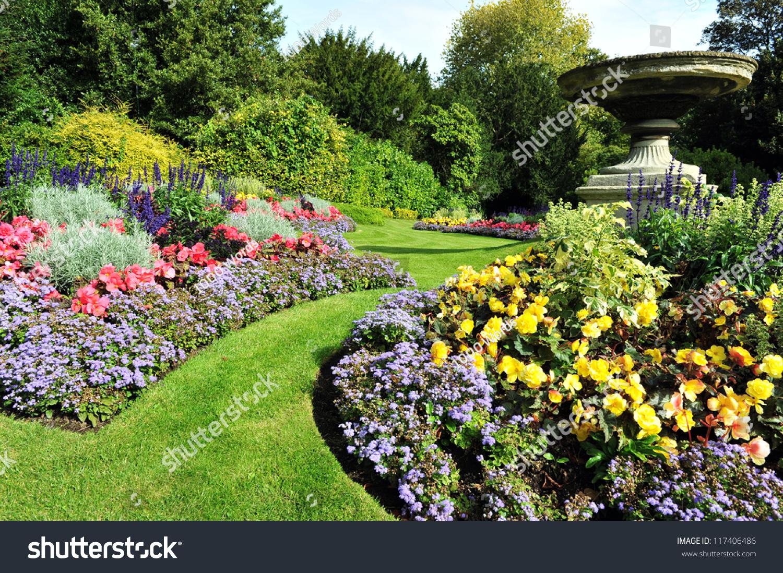 Flowerbeds grass pathway ornamental vase formal stock for Ornamental garden