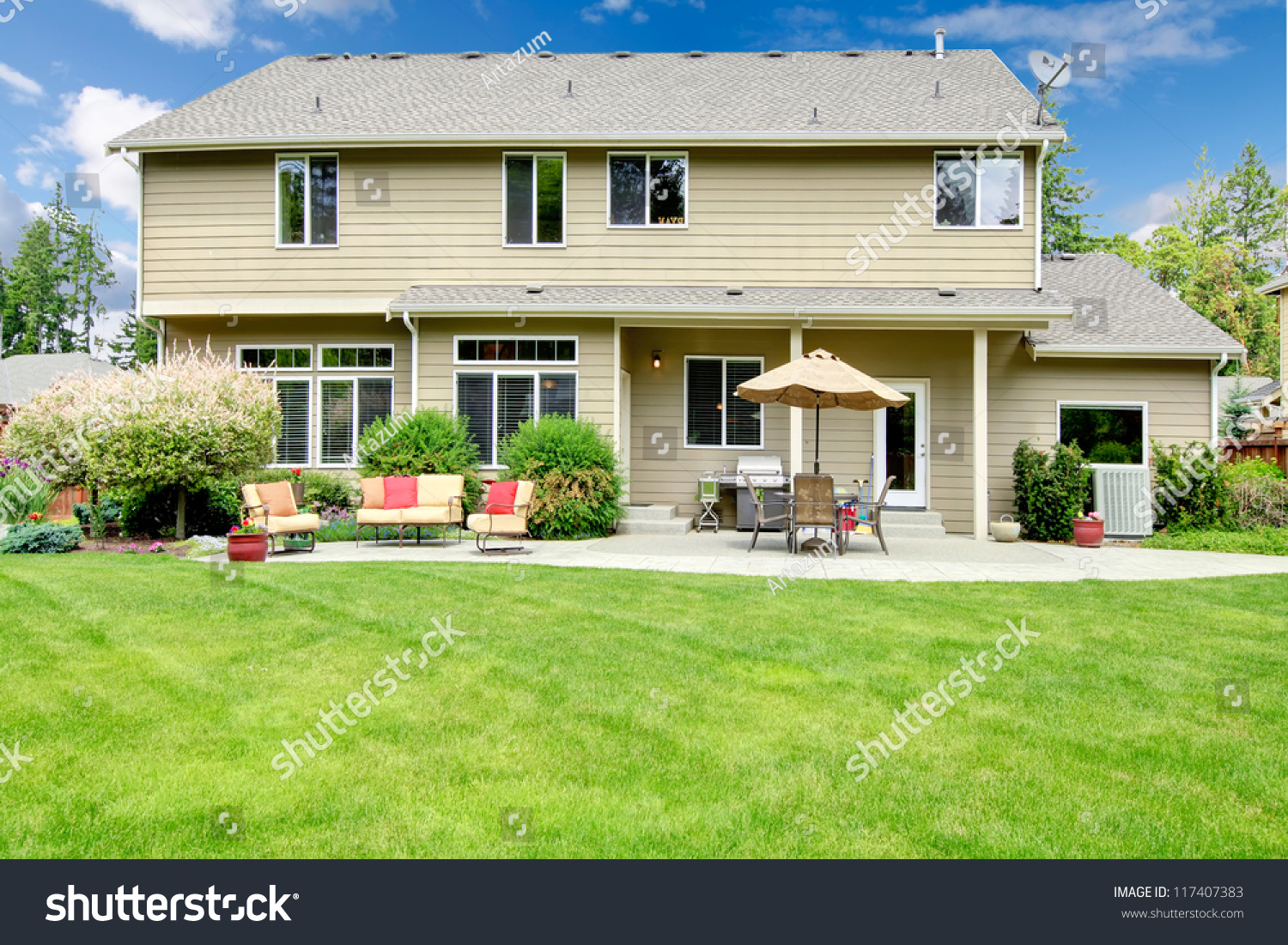 beautiful large house with backyard with sitting area and umbrella