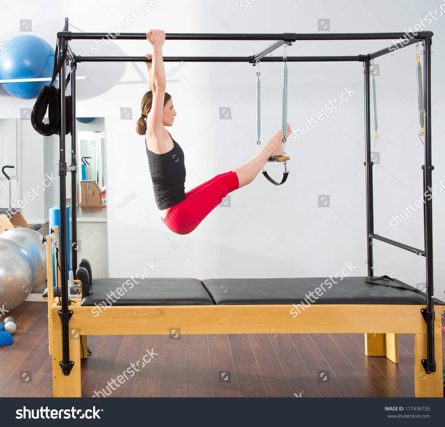 Woman Pilates Chair Exercises Fitness Stock Photo: Aerobics Pilates Instructor Woman In Cadillac Fitness