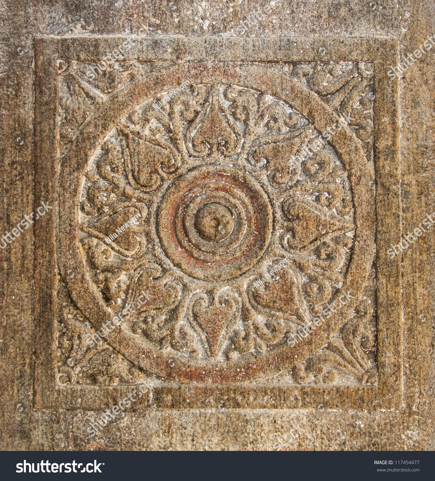 Chakra carved into ancient stone wall stock photo