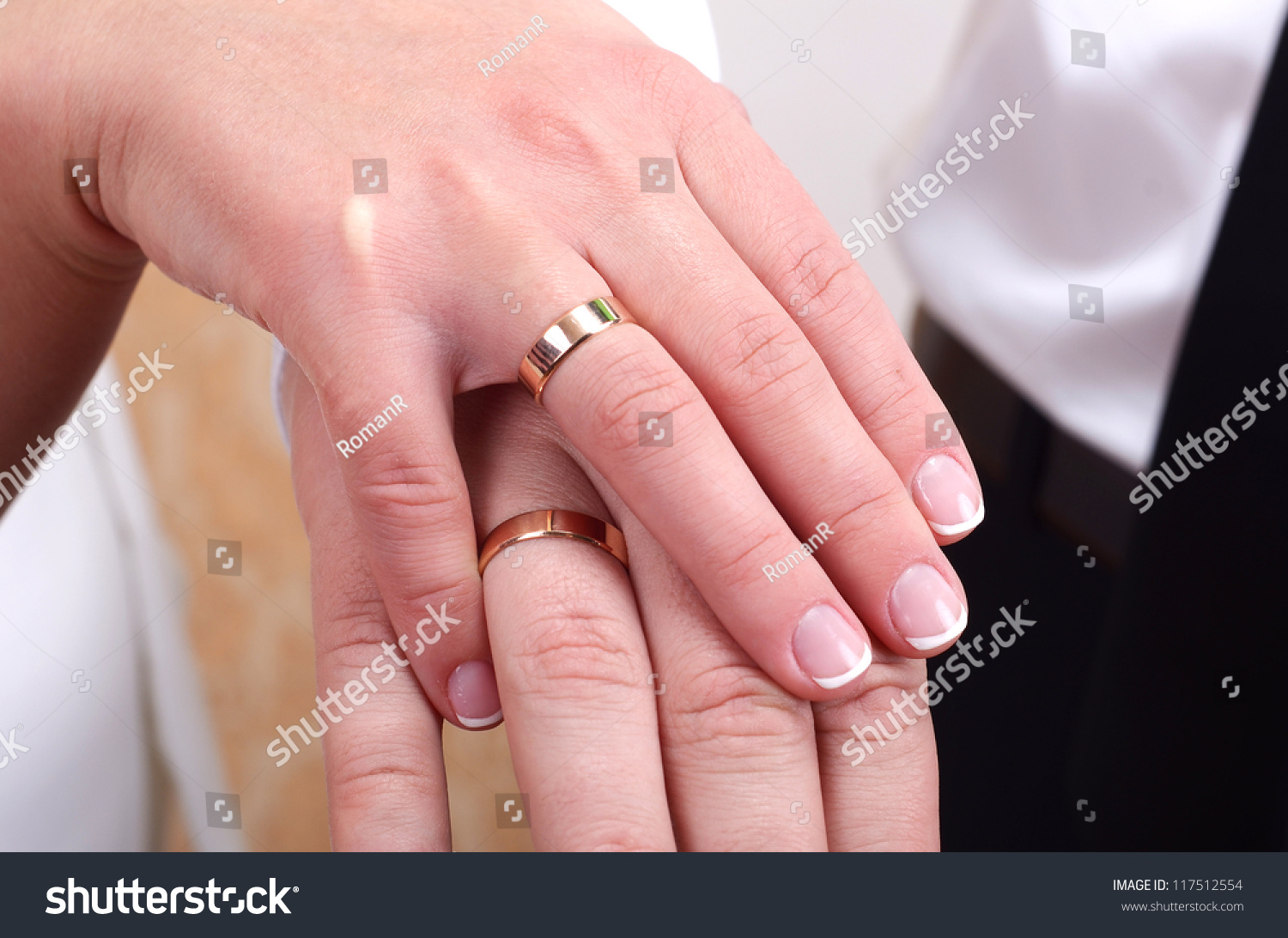 Hands and rings on wedding bouquet close up | EZ Canvas