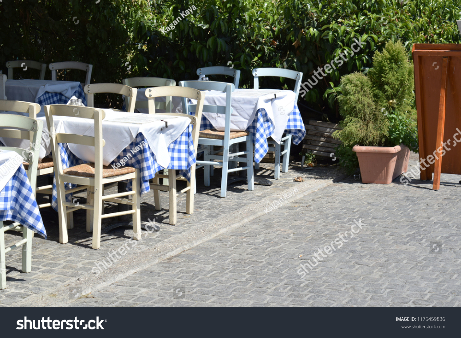 Typical outdoor tables and chairs of a restaurant in athens greece