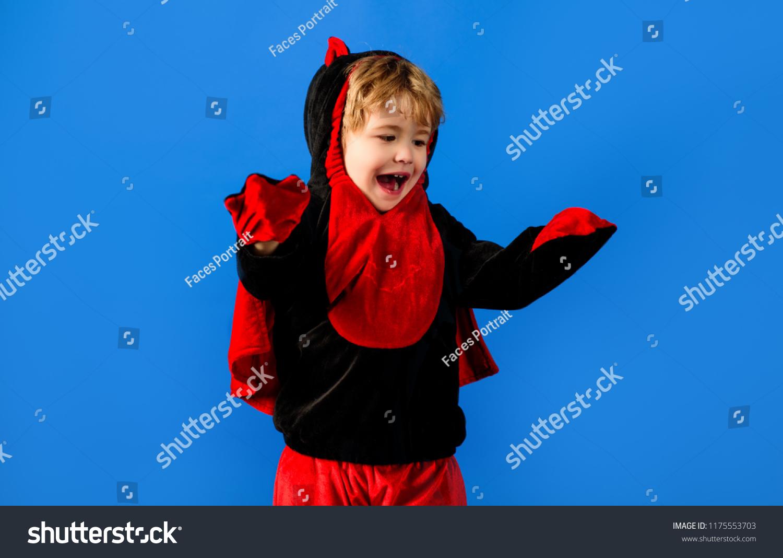 small kid boy dressed blackred dinosaur stock photo (edit now