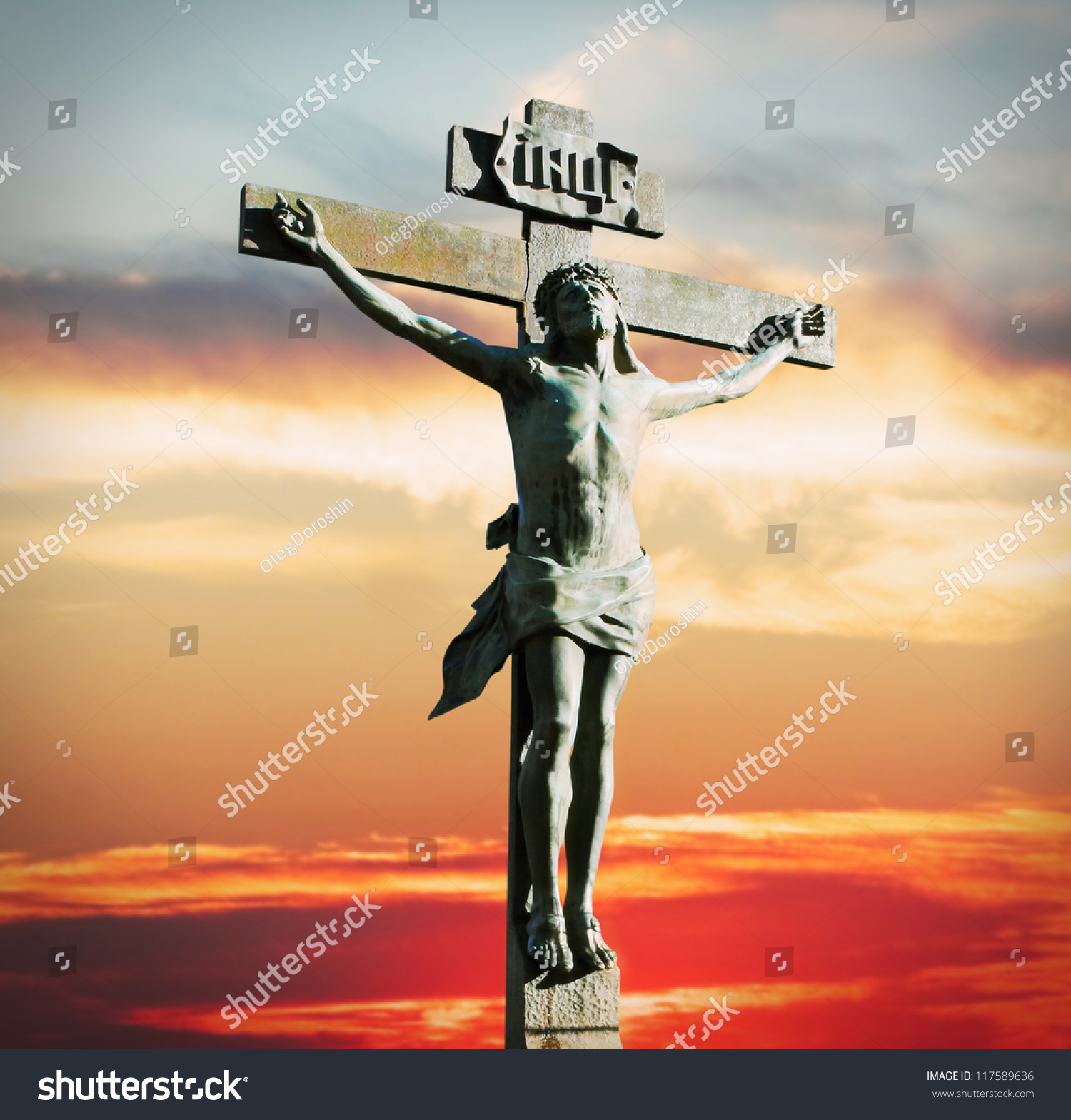 Silhouette of the holy cross on background of storm clouds stock - Crucifixion Of Jesus Christ On The Sunset In The Sky