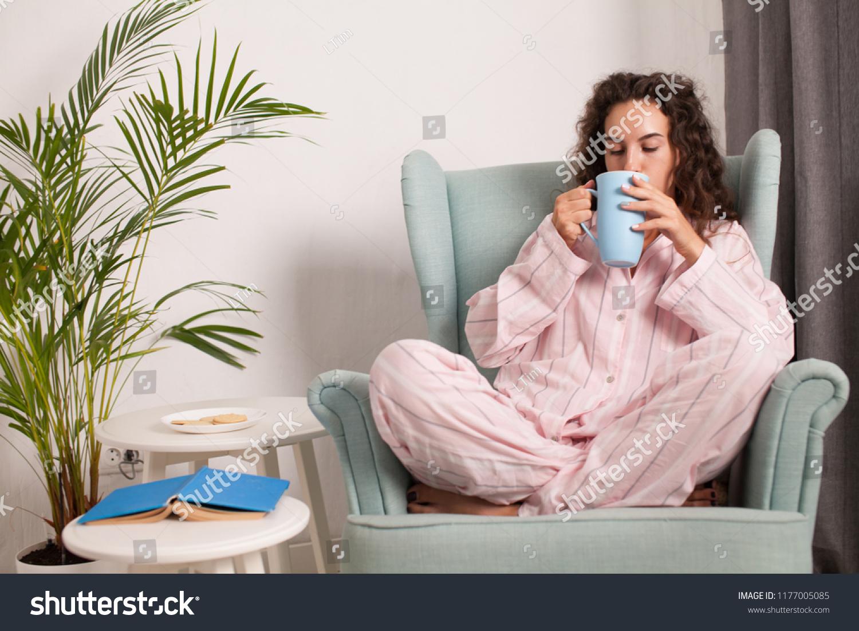 a744914fbf35 Beautiful Young Woman Wearing Pajamas Sitting Stock Photo (Edit Now ...