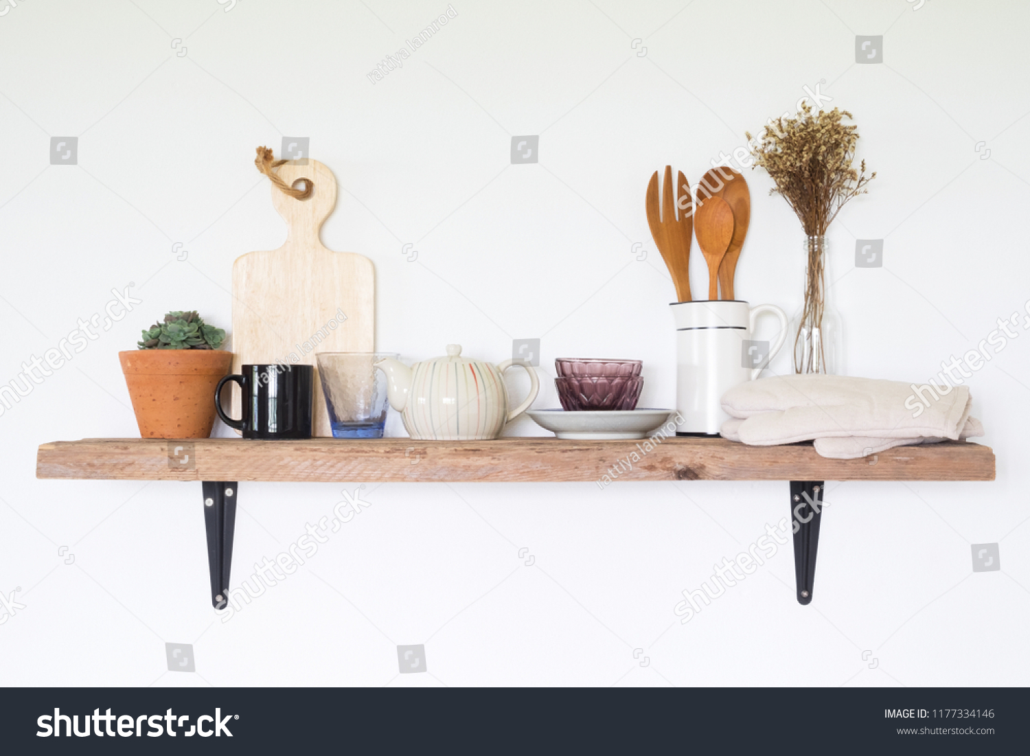 Utensils on wooden shelf in kitchen #1177334146