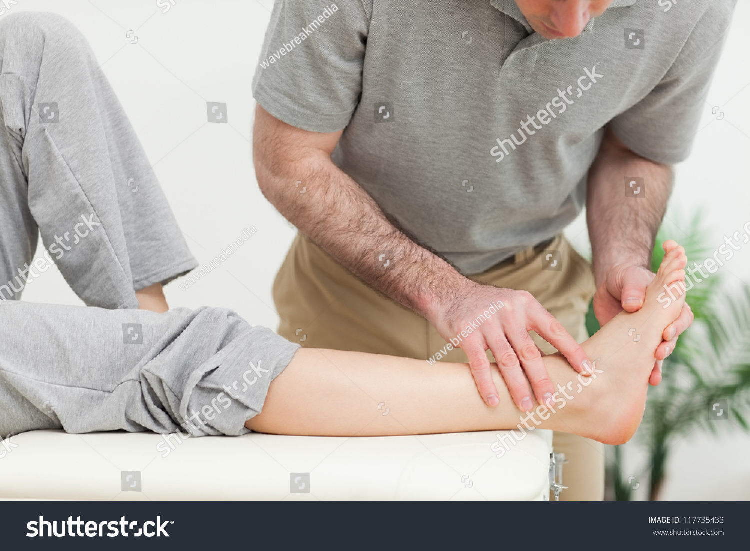 stock-photo-doctor-examining-the-foot-of-a-woman-in-a-room-117735433.jpg