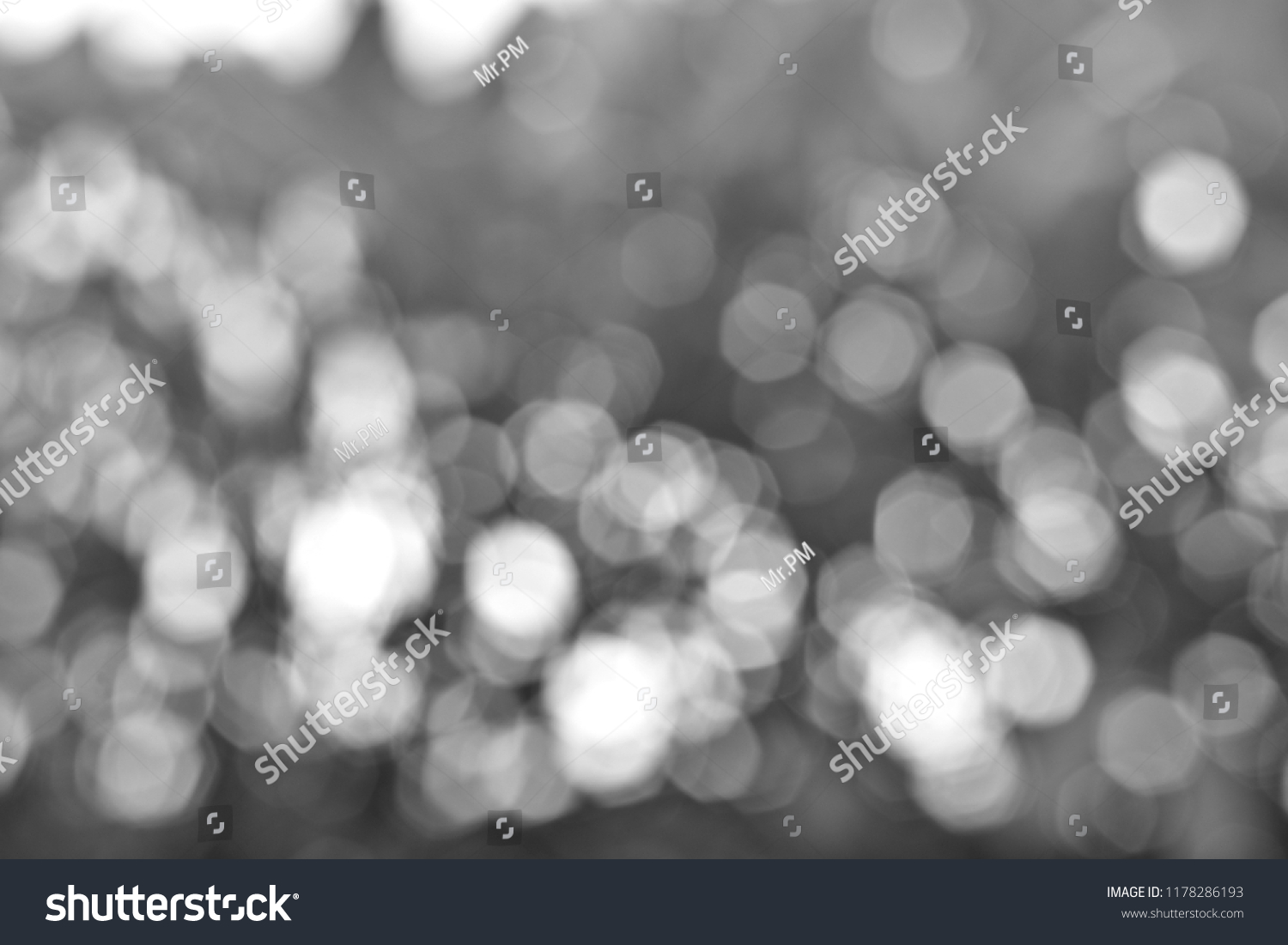 Blurred defocused scintillate abstract black and white background concept.  #1178286193