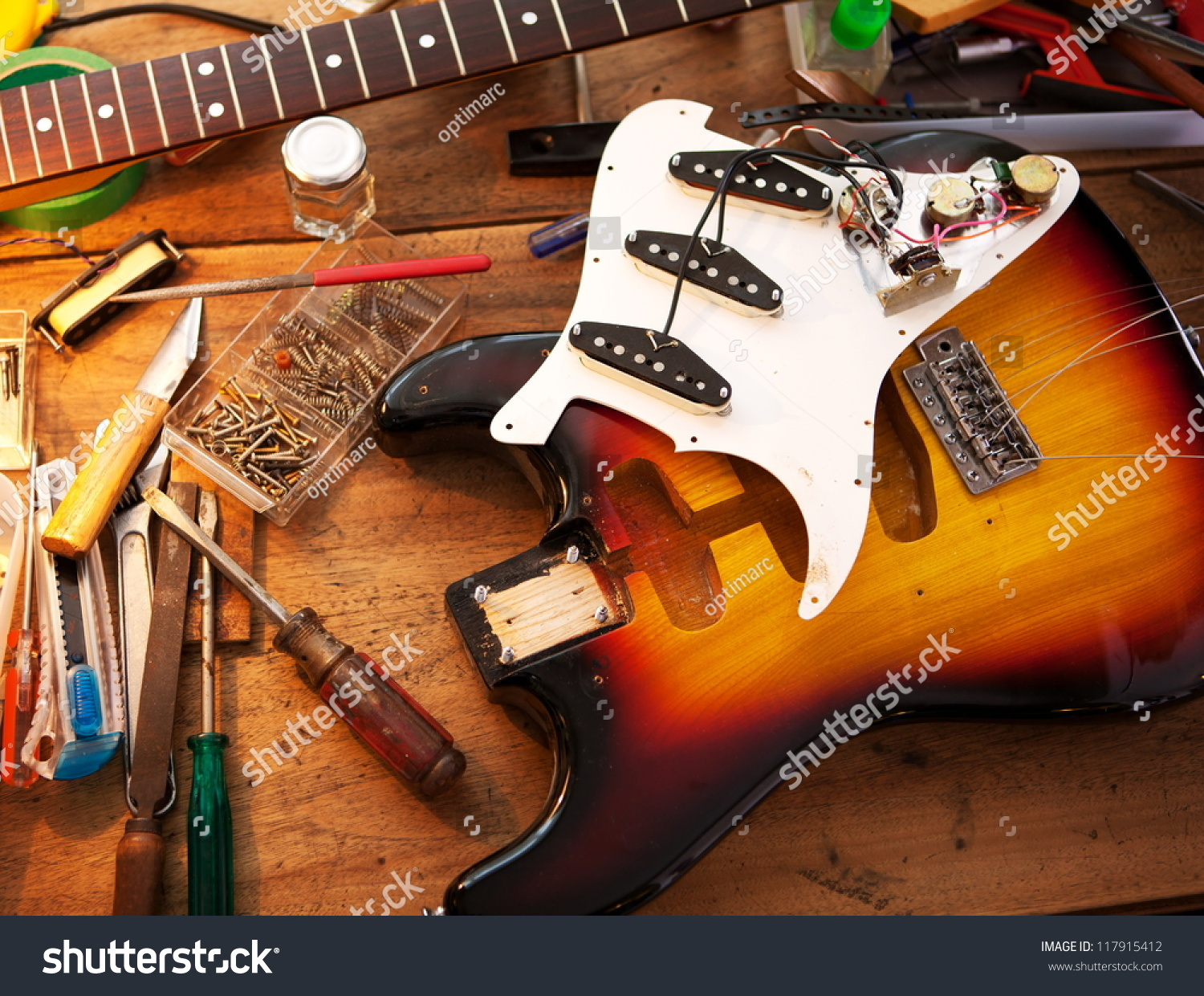 sunburst electric guitar on guitar repair stock photo 117915412 shutterstock. Black Bedroom Furniture Sets. Home Design Ideas
