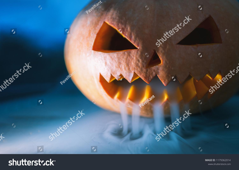 Halloween Looks Scary.Crazy Pumpkin Monster On Halloween Looks Stock Photo Edit