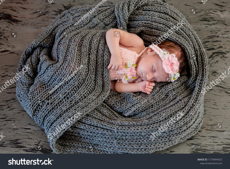 Sleeping Newborn Girl On Pink Background Photoshoot Stock Photo