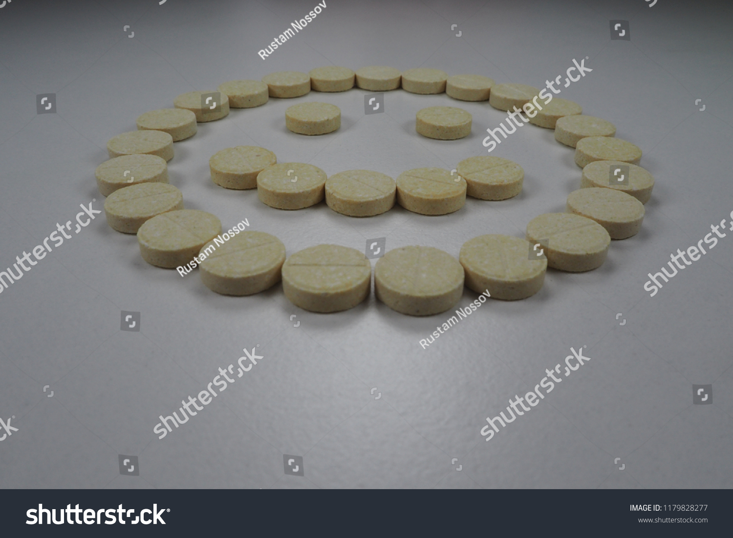 Yellow Round Tablets Laid Out Form Stock Photo (Edit Now