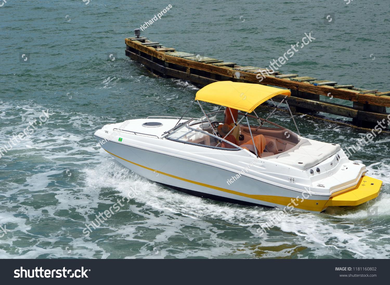 High-end inboard motor boat cruising on the florida intra-coastal waterway  off Miami