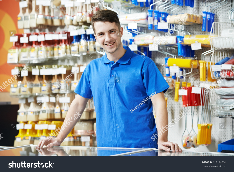 happy seller assistant man diy hardware stock photo  happy seller assistant man in diy hardware or home improvement store