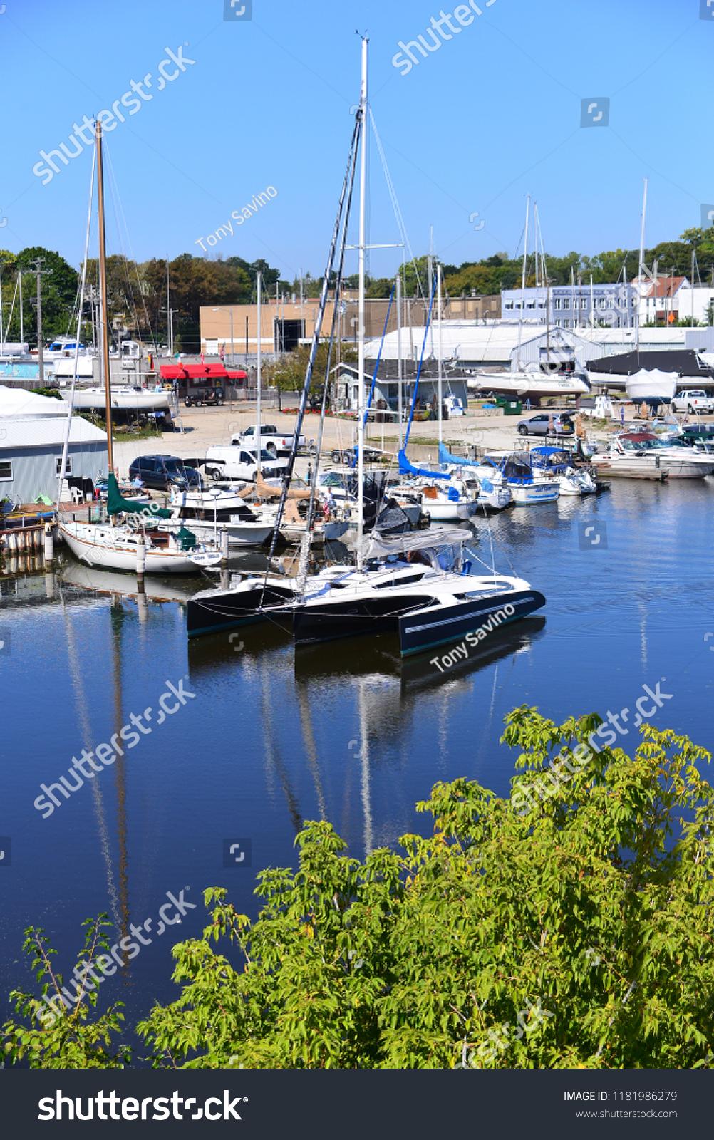 stock-photo-racine-wisconsin-usa-september-a-beautiful-three-pontoon-sailboat-named-penelope-1181986279.jpg
