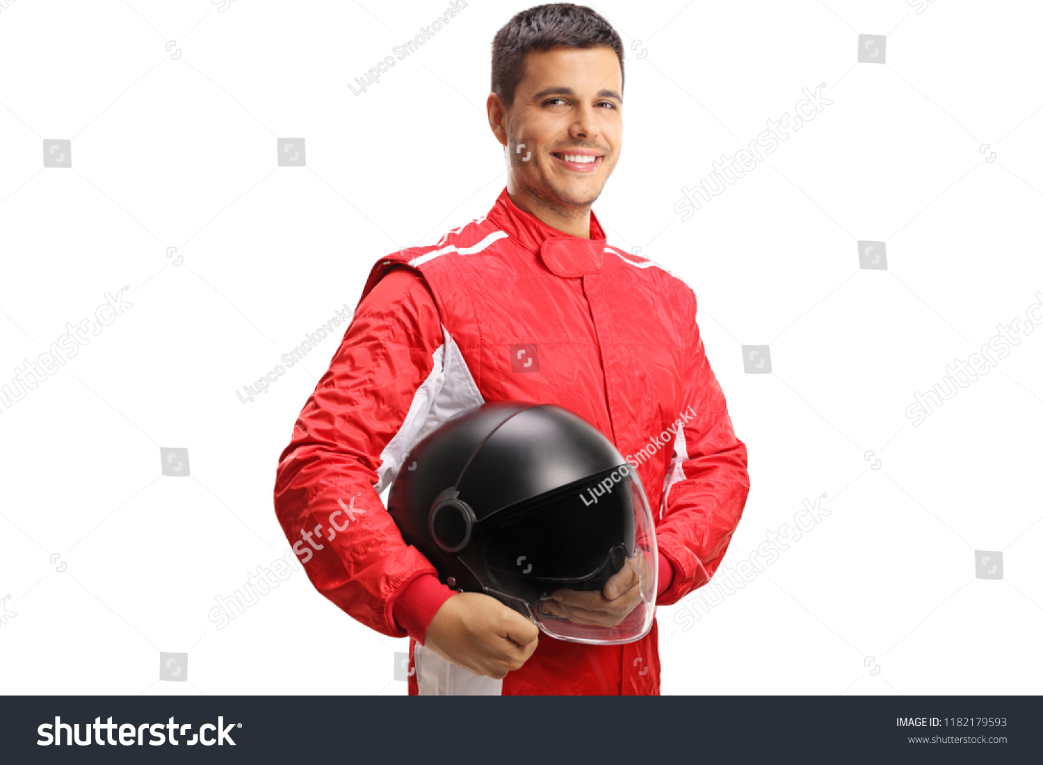 Racer with a helmet looking at the camera and smiling isolated on white background #1182179593